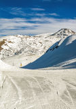 Ski slope and mountain peak in winter time. French alps stock photo