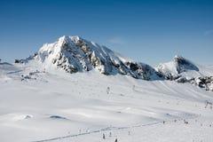 Ski slope and mountains Stock Photos