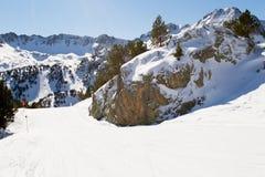 Ski slope in mountains. Stock Photo
