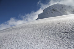 Ski slope in powder snow, mountain landscape Stock Photo