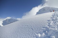 Ski slope in powder snow, mountain landscape Royalty Free Stock Photo