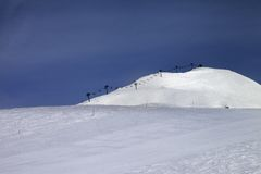 Ski slope and ropeway against blue sky Royalty Free Stock Photography