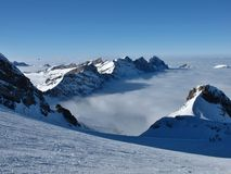 Ski slope and sea of fog, mountains Royalty Free Stock Image