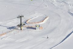 Ski slope with ski lift. In winter royalty free stock photo