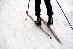 Ski slope, skier in winter forest background royalty free stock image