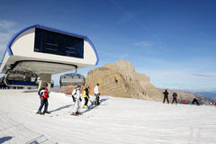 The ski slope and skiers at Passo Groste ski area Royalty Free Stock Photo
