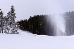 Ski slope snow machine royalty free stock images