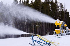 Ski slope snow machine Stock Images