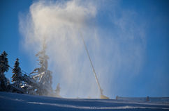 Ski slope with snow machine, pregaring for sports Royalty Free Stock Photo