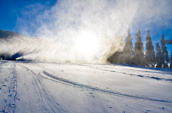 Ski slope with snow and sunshine through the trees Stock Image