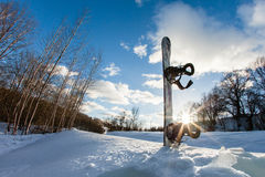 Ski slope, snowboard and blue sky Royalty Free Stock Images