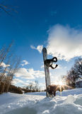 Ski slope, snowboard and blue sky Royalty Free Stock Photo