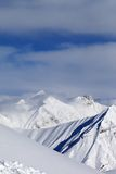 Ski slope and snowy mountains Stock Images
