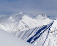 Ski slope and snowy mountains Stock Photography