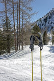 Ski slope with sticks and gloves Royalty Free Stock Photography