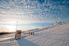 Ski slope at sunrise Stock Photo