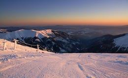 Ski slope in sunset Stock Image