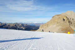 The ski slope with a view on Dolomiti mountains Stock Images