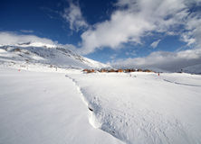 Ski slope and village in french alps. Ski slope after big dump of snow in Alpe d' Huez, France. Wide angle, photo taken 12.12.2010 Stock Images