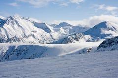 Ski slope in winter mountains. Ski slope and panorama of winter mountains. Alpine ski resort Bansko, Bulgaria Royalty Free Stock Photos