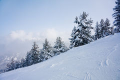 Ski slope and winter mountains panorama stock image
