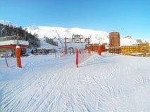 Ski slope and winter resort, French Alps. Ski slope, lift and houses of winter resort, French Alps Stock Image