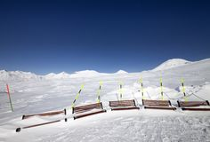 Ski slope and wooden benches in snow Royalty Free Stock Image