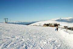 Ski slopes. Landscape; mountains; path; resort; ski; skier; skiing; slope; snow; italy; pescara; titlis; tourism; tourist; winter; mountain; blue; white; winter royalty free stock photos