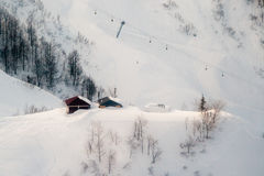 Ski slopes and cable cars. Winter mountain landscape Stock Images