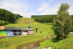 Ski slopes and lifts in summer. Mountain Tserkovka Royalty Free Stock Photos