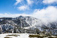 Ski slopes on Mount San Antonio Mt Baldy, fog rising up from the valley, south California royalty free stock photography