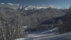 Ski slopes on North slope Aibga Ridge of Western Caucasus at Rosa Khutor Alpine Resort stock footage video stock video footage