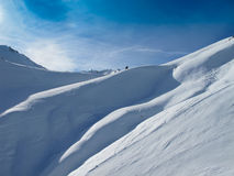 Ski slopes on sunny day in Austrian alps. Snow in high mountains Royalty Free Stock Photos