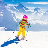 Ski and snow fun. Child in winter mountains. Royalty Free Stock Photos