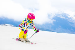 Ski and snow fun. Child in winter mountains. Stock Image