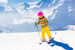 Ski and snow fun. Child in winter mountains. Royalty Free Stock Images