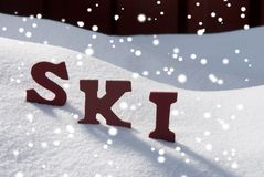 Ski On Snow With Snowflakes Christmas Season Stock Photo
