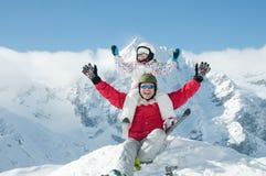 Ski,snow, sun and fun. Father with daughter have fun on ski Stock Photos