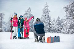 Ski, snow sun and fun - family on ski holiday taking picture stock image