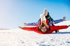 Ski, snow sun and fun - happy family on ski holiday.  Stock Images