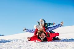 Ski, snow sun and fun - happy family on ski holiday.  Royalty Free Stock Images
