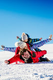 Ski, snow sun and fun - happy family on ski holiday.  Stock Photos