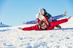 Ski, snow sun and fun - happy family on ski holiday.  Stock Photo