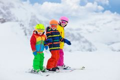 Ski and snow winter fun for kids. Children skiing stock photo