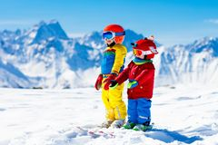 Ski and snow winter fun for kids. Children skiing. Stock Image