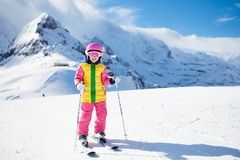 Ski and snow winter fun for kids. Children skiing. Child skiing in the mountains. Kid in ski school. Winter sport for kids. Family Christmas vacation in the Alps stock photos