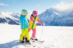 Ski and snow winter fun for kids. Children skiing stock images