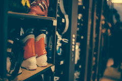 Ski and snowboard boots in the rental winter shop Stock Image