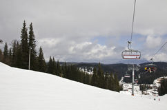 Ski and snowboard slope. With some clouds in the sky and ski lift Stock Photo