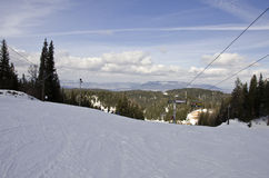 Ski and snowboard slope. With some clouds in the sky and ski lift Royalty Free Stock Photos